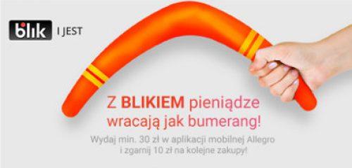 Pomarańczowy bumerang trzymany w dłoni - oferta na kupon rabatowy Allegro