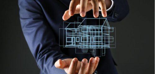 hologram domu jednorodzinnego domu w dłoniach mężczyzny