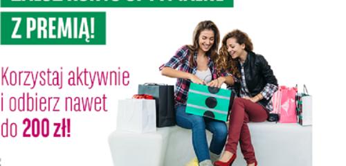 kobiety siedzące na kanapie z torbami zakupów